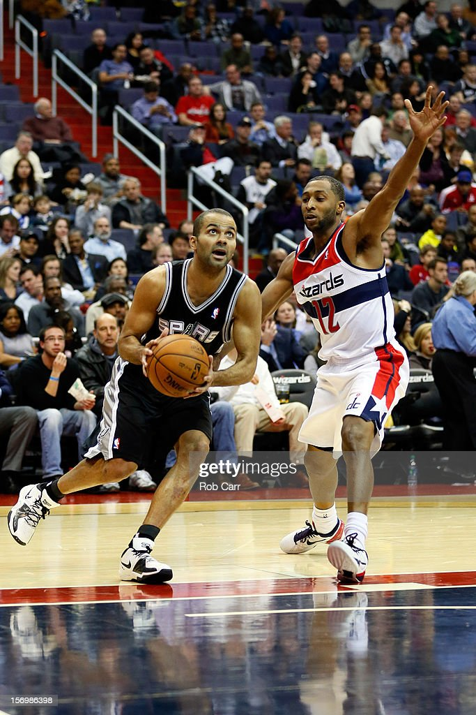 Tony Parker #9 of the San Antonio Spurs goes to the basket in front of A.J. Price #12 of the Washington Wizards during the second half of the Spurs 118-92 win at Verizon Center on November 26, 2012 in Washington, DC.