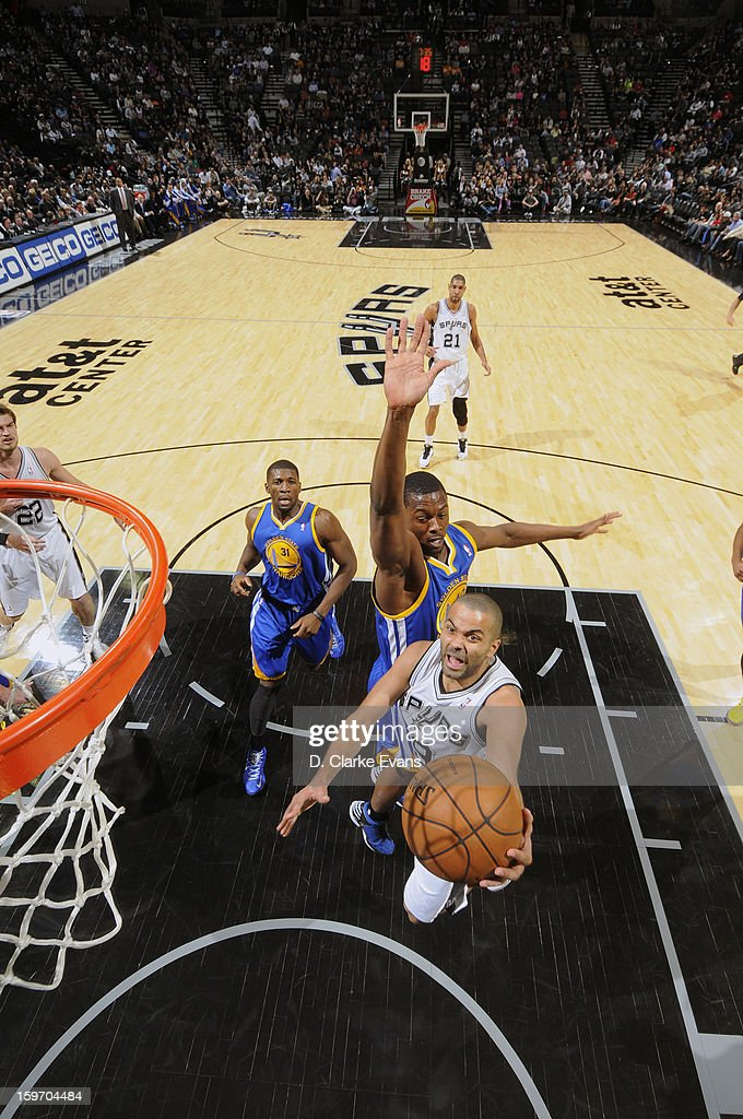 Tony Parker #9 of the San Antonio Spurs goes up for a score in a game against the Golden State Warriors on January 18, 2013 at the AT&T Center in San Antonio, Texas.