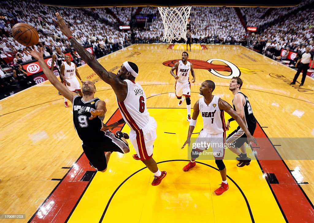 Tony Parker #9 of the San Antonio Spurs goes up for a shot against <a gi-track='captionPersonalityLinkClicked' href=/galleries/search?phrase=LeBron+James&family=editorial&specificpeople=201474 ng-click='$event.stopPropagation()'>LeBron James</a> #6 of the Miami Heat in the first quarter during Game One of the 2013 NBA Finals at AmericanAirlines Arena on June 6, 2013 in Miami, Florida.