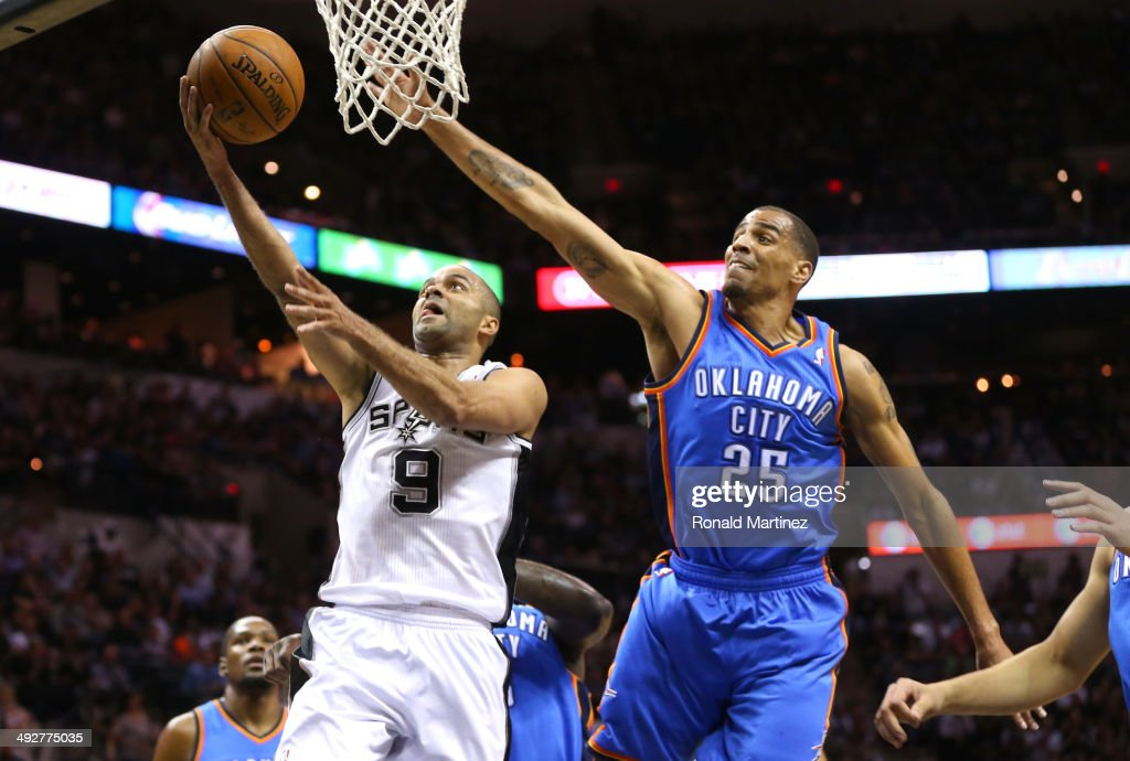 Tony Parker #9 of the San Antonio Spurs goes up for a shot against Thabo Sefolosha #25 of the Oklahoma City Thunder in the first quarter in Game Two of the Western Conference Finals during the 2014 NBA Playoffs at AT&T Center on May 21, 2014 in San Antonio, Texas.