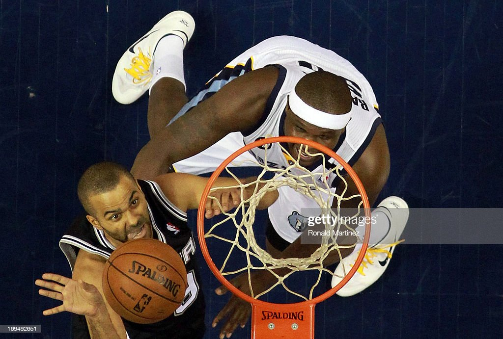Tony Parker #9 of the San Antonio Spurs goes up for a shot against <a gi-track='captionPersonalityLinkClicked' href=/galleries/search?phrase=Zach+Randolph&family=editorial&specificpeople=201595 ng-click='$event.stopPropagation()'>Zach Randolph</a> #50 of the Memphis Grizzlies in the first half during Game Three of the Western Conference Finals of the 2013 NBA Playoffs at the FedExForum on May 25, 2013 in Memphis, Tennessee.
