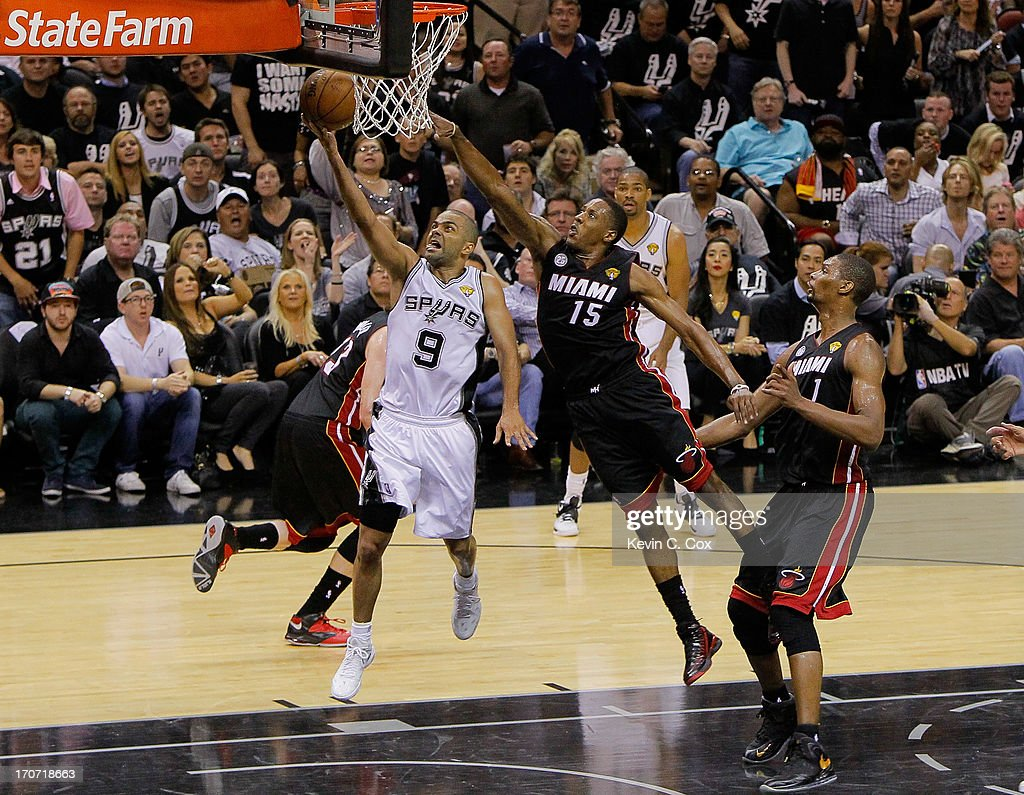 <a gi-track='captionPersonalityLinkClicked' href=/galleries/search?phrase=Tony+Parker&family=editorial&specificpeople=160952 ng-click='$event.stopPropagation()'>Tony Parker</a> #9 of the San Antonio Spurs goes up for a shot in front of <a gi-track='captionPersonalityLinkClicked' href=/galleries/search?phrase=Mario+Chalmers&family=editorial&specificpeople=802115 ng-click='$event.stopPropagation()'>Mario Chalmers</a> #15 of the Miami Heat in the second half during Game Five of the 2013 NBA Finals at the AT&T Center on June 16, 2013 in San Antonio, Texas.