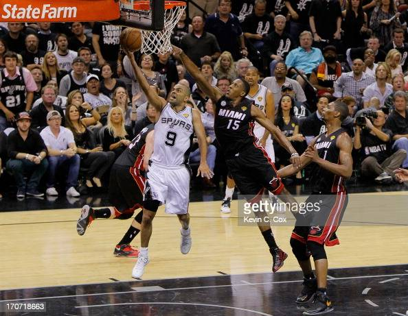 Tony Parker of the San Antonio Spurs goes up for a shot in front of Mario Chalmers of the Miami Heat in the second half during Game Five of the 2013...