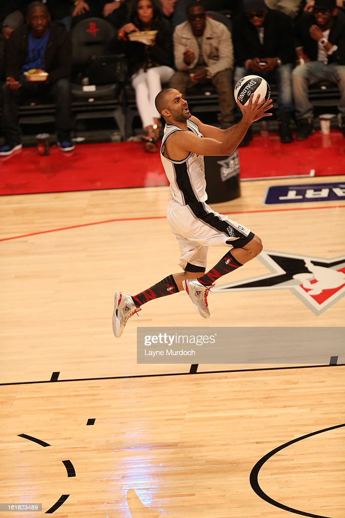 <a gi-track='captionPersonalityLinkClicked' href=/galleries/search?phrase=Tony+Parker&family=editorial&specificpeople=160952 ng-click='$event.stopPropagation()'>Tony Parker</a> #9 of the San Antonio Spurs goes up for the easy layup during 2013 Taco Bell Skills Challenge on State Farm All-Star Saturday Night as part of 2013 NBA All-Star Weekend on February 16, 2013 at Toyota Center in Houston, Texas.