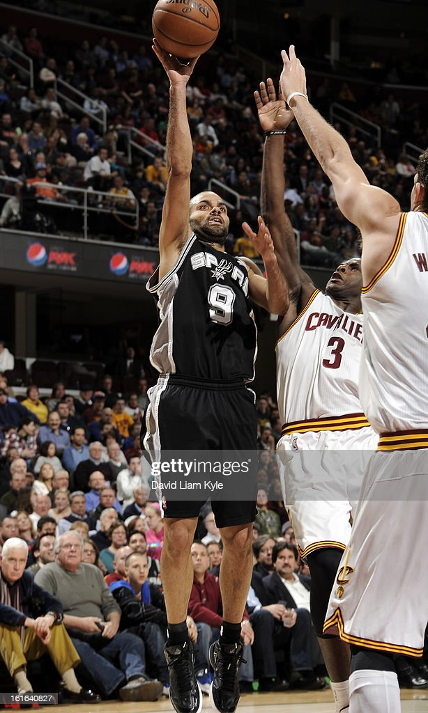 Tony Parker #9 of the San Antonio Spurs goes up for the shot against Dion Waiters #3 of the Cleveland Cavaliers at The Quicken Loans Arena on February 13, 2013 in Cleveland, Ohio.