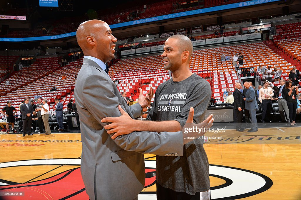 Tony Parker #9 of the San Antonio Spurs greets <a gi-track='captionPersonalityLinkClicked' href=/galleries/search?phrase=Bruce+Bowen&family=editorial&specificpeople=201662 ng-click='$event.stopPropagation()'>Bruce Bowen</a> before Game Three of the 2014 NBA Finals against the Miami Heat on June 10, 2014 at American Airlines Arena in Miami, Florida.