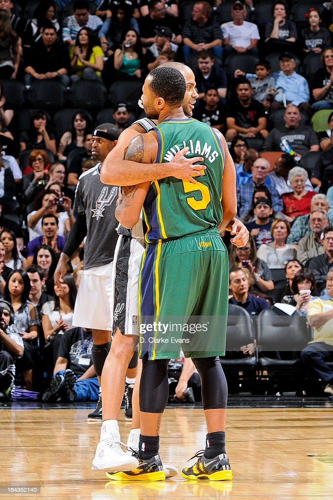 Tony Parker #9 of the San Antonio Spurs greets Mo Williams #5 of the Utah Jazz before their game on March 22, 2013 at the AT&T Center in San Antonio, Texas.