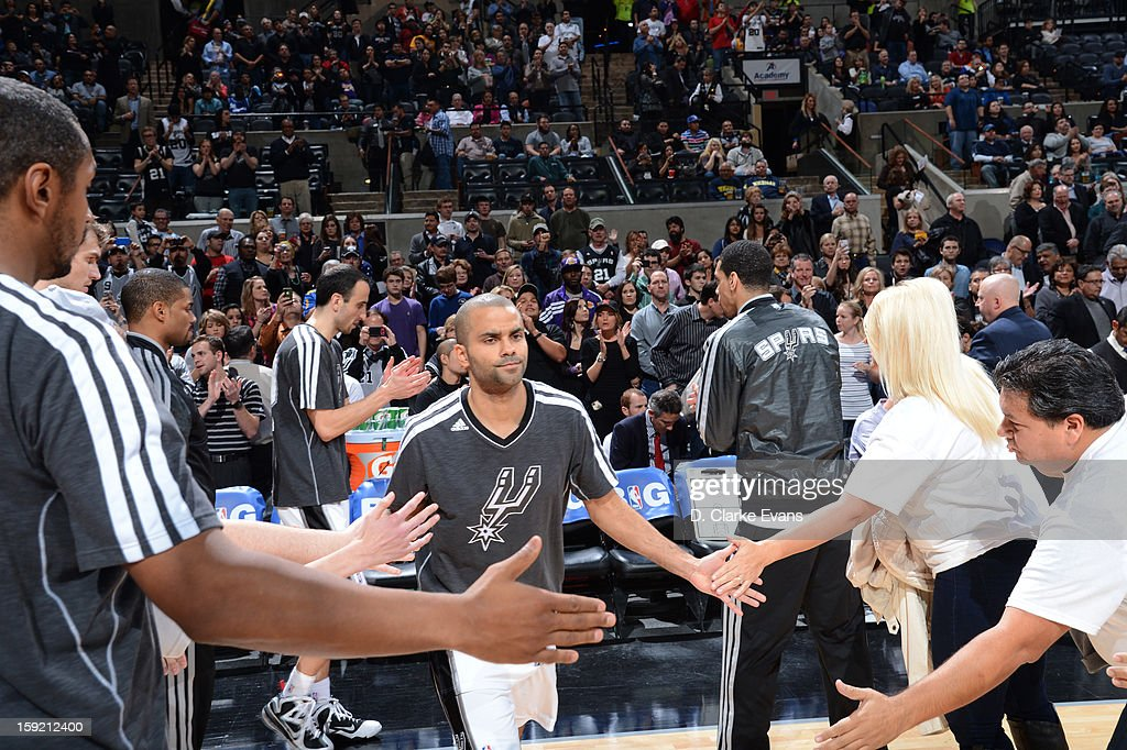 Tony Parker #9 of the San Antonio Spurs greets teammates as he enters the court during the game between the Los Angeles Lakers and the San Antonio Spurs on January 9, 2013 at the AT&T Center in San Antonio, Texas.