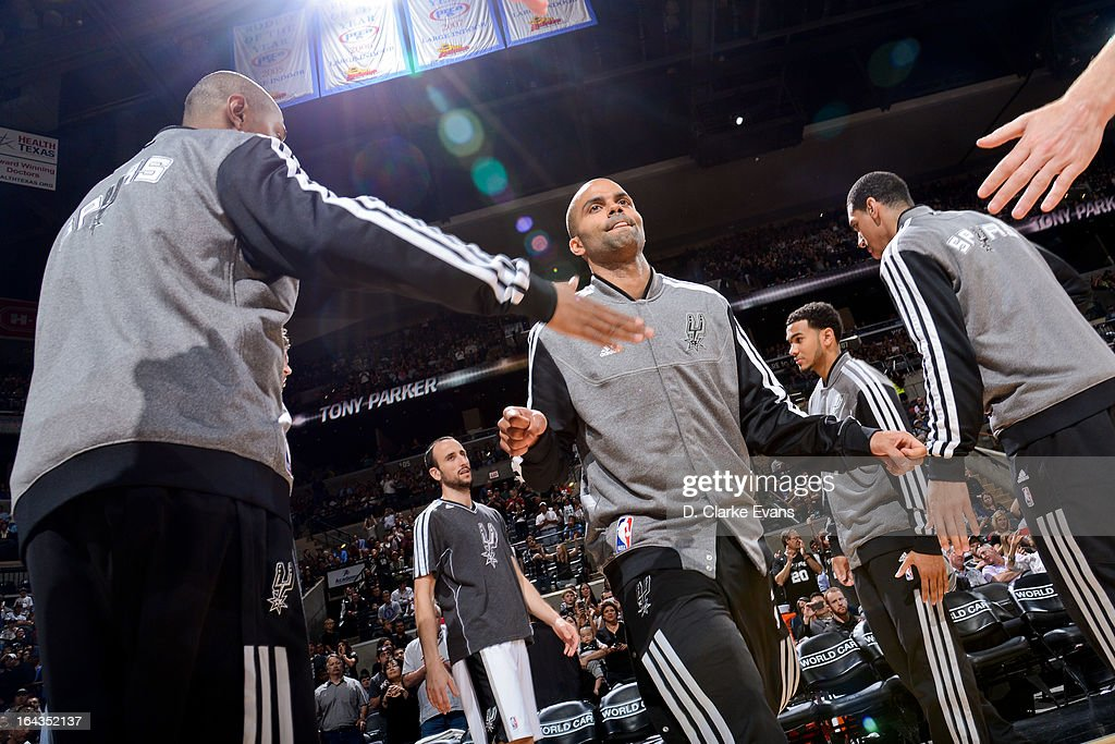 Tony Parker #9 of the San Antonio Spurs greets teammates before playing against the Utah Jazz on March 22, 2013 at the AT&T Center in San Antonio, Texas.