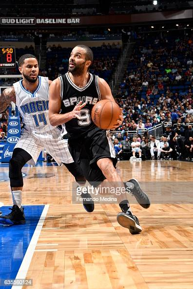 Tony Parker of the San Antonio Spurs handles the ball against DJ Augustin of the Orlando Magic during the game on February 15 2017 at Amway Center in...