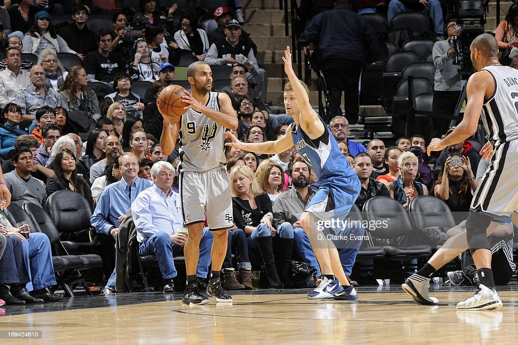 Tony Parker #9 of the San Antonio Spurs handles the ball against <a gi-track='captionPersonalityLinkClicked' href=/galleries/search?phrase=Luke+Ridnour&family=editorial&specificpeople=201824 ng-click='$event.stopPropagation()'>Luke Ridnour</a> #13 of the Minnesota Timberwolves on January 13, 2013 at the AT&T Center in San Antonio, Texas.
