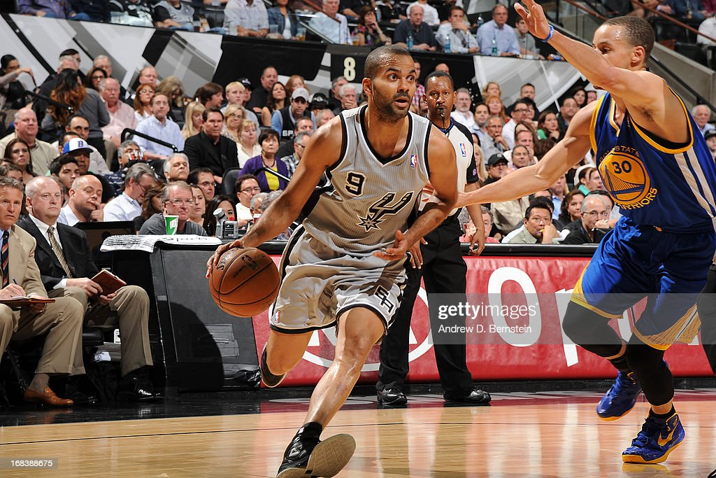 Tony Parker #9 of the San Antonio Spurs handles the ball against Stephen Curry #30 of the Golden State Warriors in Game Two of the Western Conference Semifinals during the 2013 NBA Playoffs on May 8, 2013 at the AT&T Center in San Antonio, Texas.