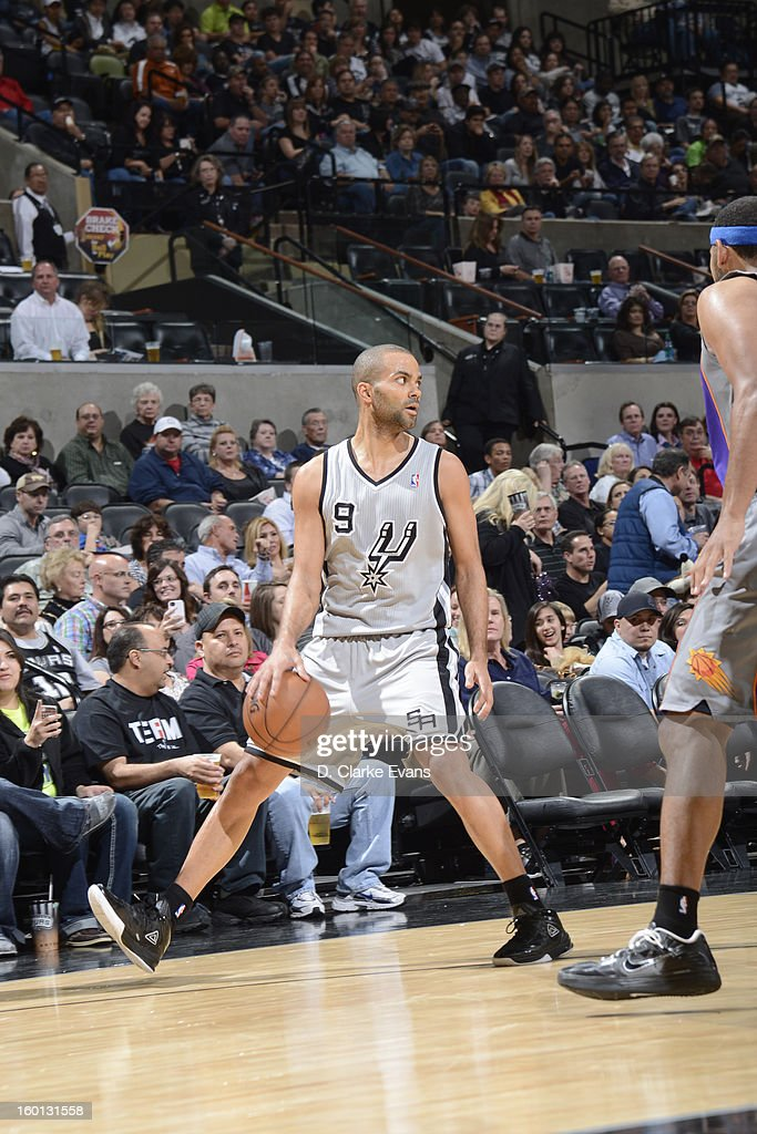 Tony Parker #9 of the San Antonio Spurs handles the ball against the Phoenix Suns on January 26, 2013 at the AT&T Center in San Antonio, Texas.
