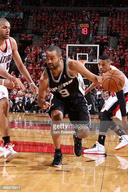 Tony Parker of the San Antonio Spurs handles the ball against the Portland Trail Blazers in Game Three of the Western Conference Semifinals during...