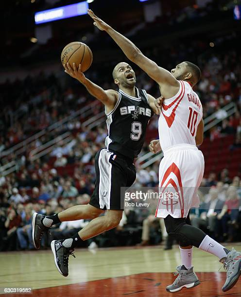Tony Parker of the San Antonio Spurs has his shot attempt blocked by Eric Gordon of the Houston Rockets at Toyota Center on December 20 2016 in...