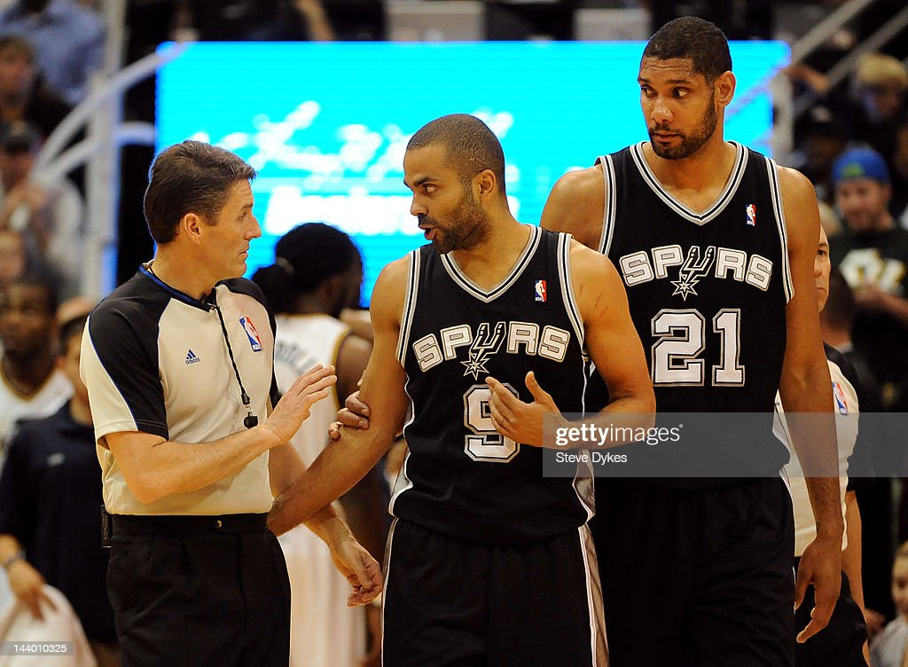 Tony Parker #9 of the San Antonio Spurs has some words with the referee as <a gi-track='captionPersonalityLinkClicked' href=/galleries/search?phrase=Tim+Duncan&family=editorial&specificpeople=201467 ng-click='$event.stopPropagation()'>Tim Duncan</a> #21 of the San Antonio Spurs looks on during the fourth quarter of Game Four of the Western Conference Quarterfinals against the Utah Jazz in the 2012 NBA Playoffs at EnergySolutions Arena on May 07, 2012 in Salt Lake City, Utah. The Spurs won the game 87-81 and swept the Jazz four games to zero.