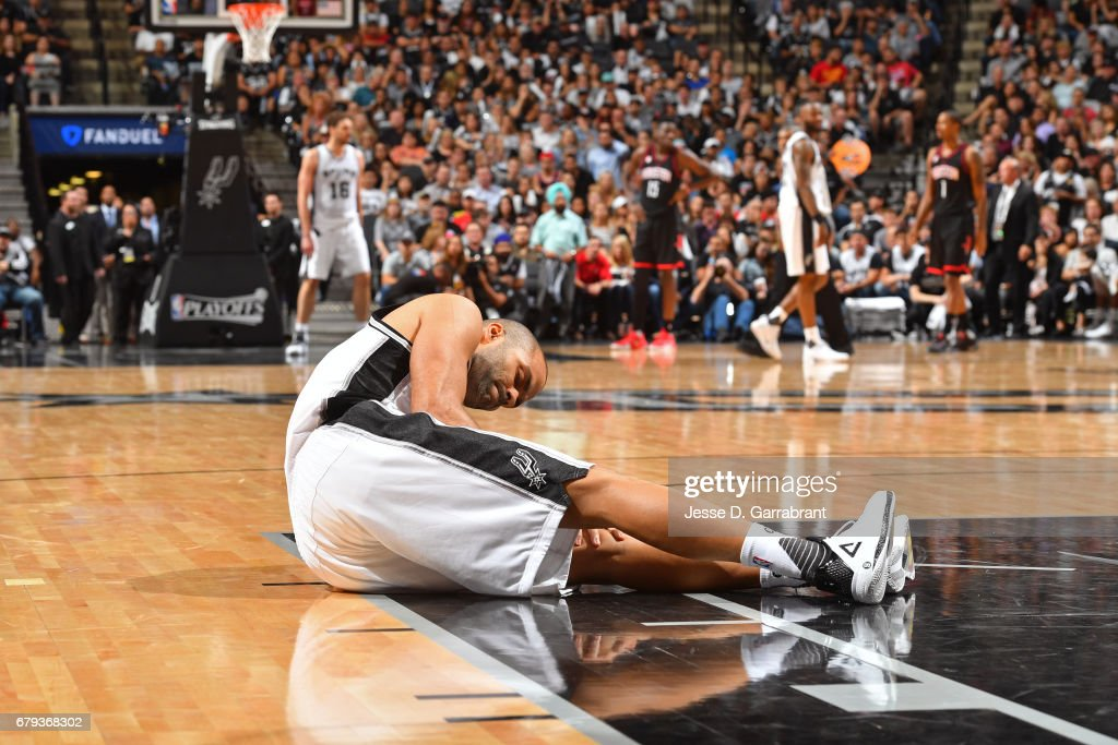 Tony Parker #9 of the San Antonio Spurs holds his knee after sustaining an injury during Game Two of the Western Conference Semifinals against the Houston Rockets in the 2017 NBA Playoffs on May 3, 2017 at the AT&T Center in San Antonio, Texas.
