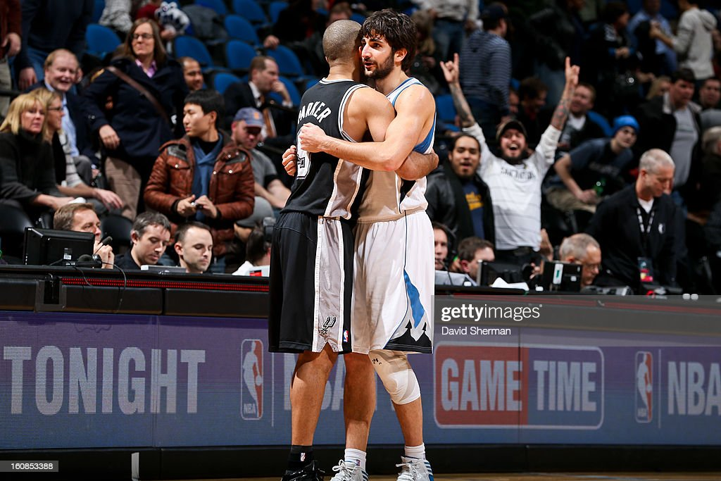 Tony Parker #9 of the San Antonio Spurs hugs Ricky Rubio #9 of the Minnesota Timberwolves following their game on February 6, 2013 at Target Center in Minneapolis, Minnesota.