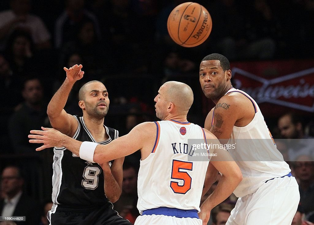 Tony Parker #9 of the San Antonio Spurs in action against Jason Kidd #5 and Marcus Camby #23 of the New York Knicks at Madison Square Garden on January 3, 2013 in New York City. The Knicks defeated the Spurs 100-83.