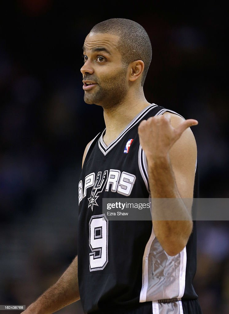 Tony Parker #9 of the San Antonio Spurs in action against the Golden State Warriors at Oracle Arena on February 22, 2013 in Oakland, California. The Warriors are wearing new short-sleeved uniforms for the first time. The Warriors won the game in overtime.