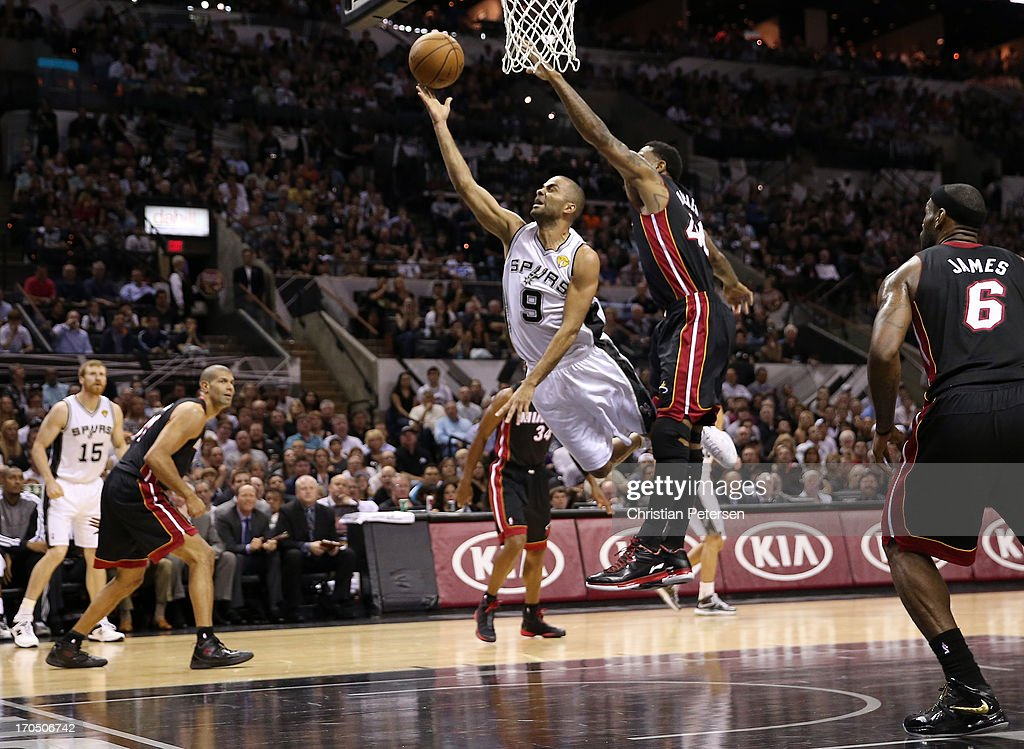 Tony Parker #9 of the San Antonio Spurs lays the ball up against Udonis Haslem #40 of the Miami Heat in the first half during Game Four of the 2013 NBA Finals at the AT&T Center on June 13, 2013 in San Antonio, Texas.
