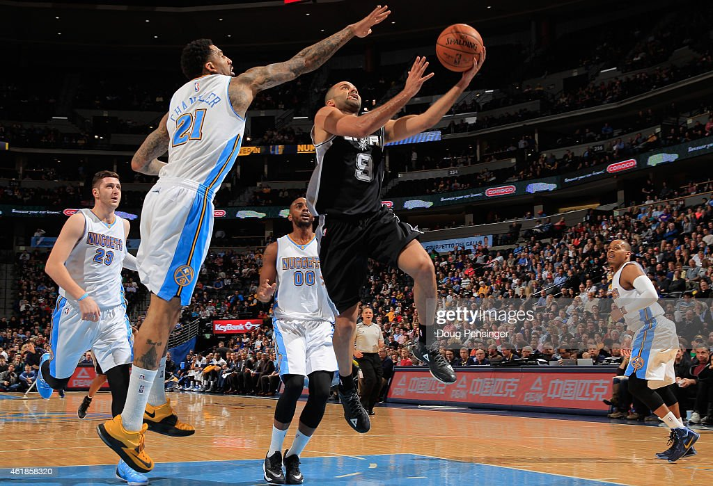 Tony Parker #9 of the San Antonio Spurs lays up a shot against <a gi-track='captionPersonalityLinkClicked' href=/galleries/search?phrase=Wilson+Chandler&family=editorial&specificpeople=809324 ng-click='$event.stopPropagation()'>Wilson Chandler</a> #21 of the Denver Nuggets as Jusuf Nurkic #23, <a gi-track='captionPersonalityLinkClicked' href=/galleries/search?phrase=Darrell+Arthur&family=editorial&specificpeople=4102032 ng-click='$event.stopPropagation()'>Darrell Arthur</a> #00 and <a gi-track='captionPersonalityLinkClicked' href=/galleries/search?phrase=Randy+Foye&family=editorial&specificpeople=240185 ng-click='$event.stopPropagation()'>Randy Foye</a> #4 of the Denver Nuggets follow the play at Pepsi Center on January 20, 2015 in Denver, Colorado. The Spurs defeated the Nuggets 109-99.