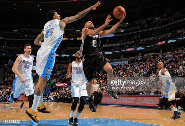 Tony Parker of the San Antonio Spurs lays up a shot against Wilson Chandler of the Denver Nuggets as Jusuf Nurkic Darrell Arthur and Randy Foye of...