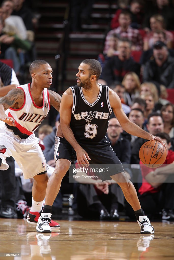 Tony Parker #9 of the San Antonio Spurs looks to drive to the basket while guarded by <a gi-track='captionPersonalityLinkClicked' href=/galleries/search?phrase=Damian+Lillard&family=editorial&specificpeople=6598327 ng-click='$event.stopPropagation()'>Damian Lillard</a> #0 of the Portland Trail Blazers on December 13, 2012 at the Rose Garden Arena in Portland, Oregon.