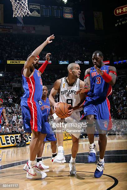 Tony Parker of the San Antonio Spurs looks to pass against Rasheed Wallace and Ben Wallace of the Detroit Pistons in Game Seven of the 2005 NBA...