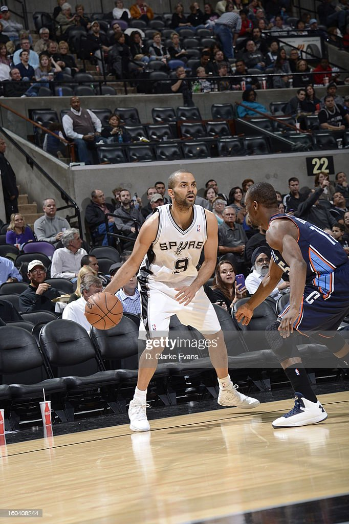 Tony Parker #9 of the San Antonio Spurs looks to pass the ball against Kemba Walker #15 of the Charlotte Bobcats on January 30, 2013 at the AT&T Center in San Antonio, Texas.
