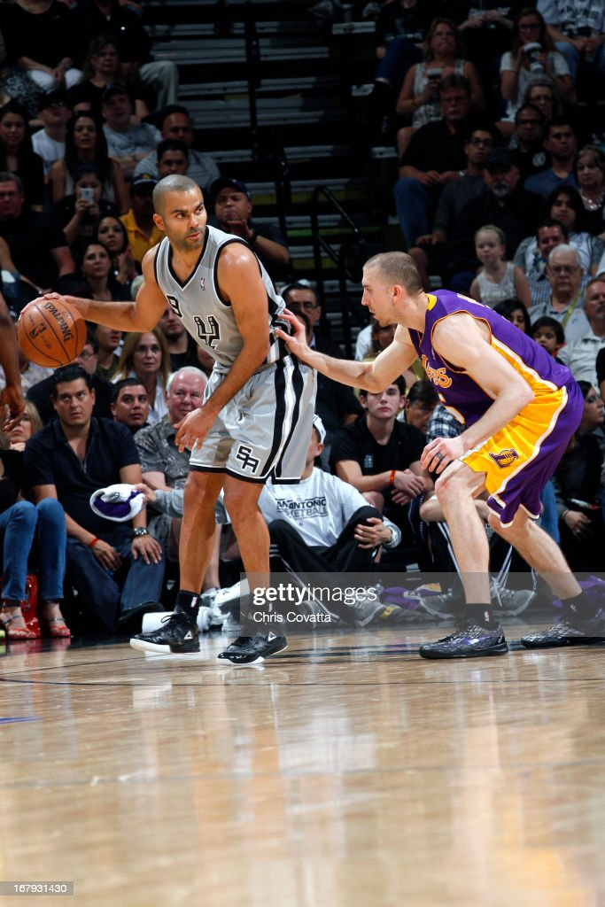 Tony Parker #9 of the San Antonio Spurs looks to pass the ball against the Los Angeles Lakers in Game One of the 2013 NBA Playoffs at the AT&T Center on April 21, 2013 in San Antonio, Texas.