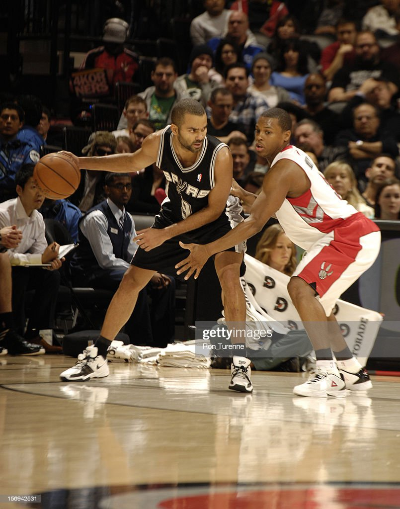 Tony Parker #9 of the San Antonio Spurs looks to pass the ball vs the Toronto Raptors during the game on November 25, 2012 at the Air Canada Centre in Toronto, Ontario, Canada.