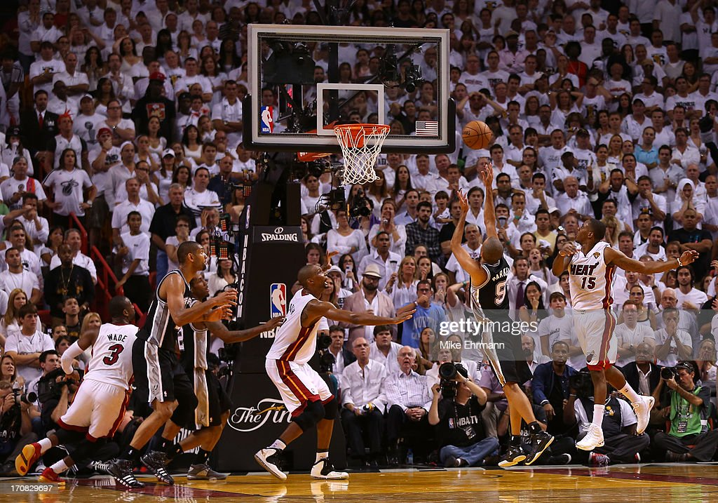 Tony Parker #9 of the San Antonio Spurs makes a basket over Mario Chalmers #15 of the Miami Heat in the fourth quarter during Game Six of the 2013 NBA Finals at AmericanAirlines Arena on June 18, 2013 in Miami, Florida.