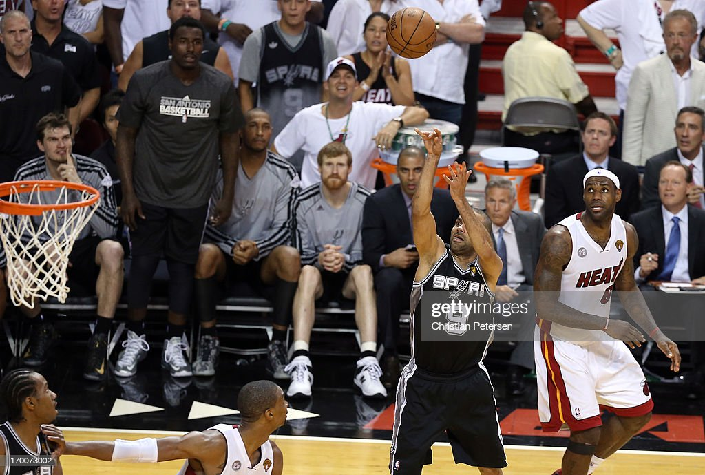 Tony Parker #9 of the San Antonio Spurs makes a shot with 5.2 seconds left in the fourth quarter against <a gi-track='captionPersonalityLinkClicked' href=/galleries/search?phrase=LeBron+James&family=editorial&specificpeople=201474 ng-click='$event.stopPropagation()'>LeBron James</a> #6 of the Miami Heat during Game One of the 2013 NBA Finals at AmericanAirlines Arena on June 6, 2013 in Miami, Florida.