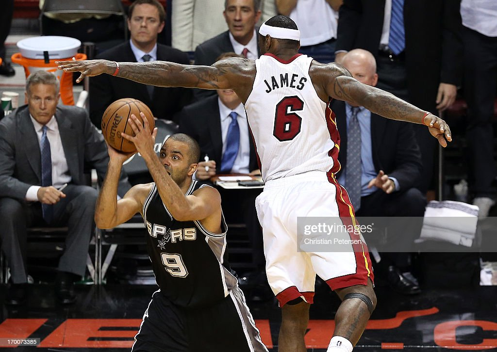 Tony Parker #9 of the San Antonio Spurs makes a shot with 5.2 seconds left in the fourth quarter against LeBron James #6 of the Miami Heat during Game One of the 2013 NBA Finals at AmericanAirlines Arena on June 6, 2013 in Miami, Florida.