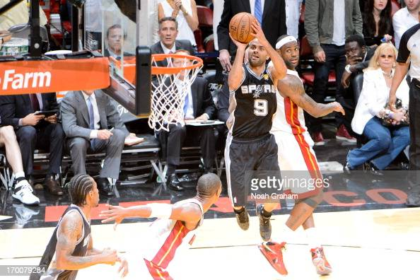Tony Parker of the San Antonio Spurs makes a shot with seconds left in the fourth quarter to put his team ahead by four points against LeBron James...