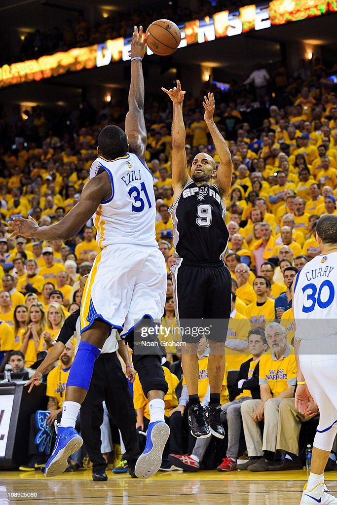 Tony Parker #9 of the San Antonio Spurs makes a three-pointer late in the fourth quarter against Festus Ezeli #31 of the Golden State Warriors in Game Six of the Western Conference Semifinals during the 2013 NBA Playoffs on May 16, 2013 at Oracle Arena in Oakland, California.