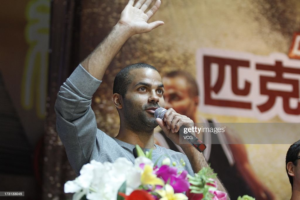 <a gi-track='captionPersonalityLinkClicked' href=/galleries/search?phrase=Tony+Parker&family=editorial&specificpeople=160952 ng-click='$event.stopPropagation()'>Tony Parker</a> of the San Antonio Spurs meets with with fans at Quanzhou No.7 Middle School on July 8, 2013 in Quanzhou, China.
