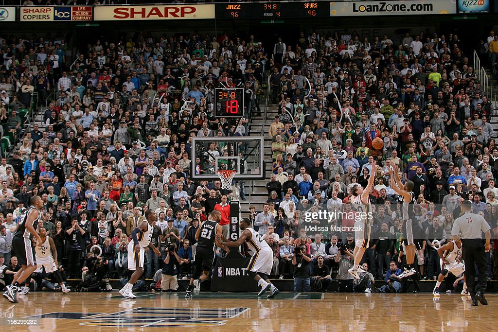 Tony Parker #9 of the San Antonio Spurs misses a go-ahead shot in the fourth quarter against <a gi-track='captionPersonalityLinkClicked' href=/galleries/search?phrase=Gordon+Hayward&family=editorial&specificpeople=5767271 ng-click='$event.stopPropagation()'>Gordon Hayward</a> #20 of the Utah Jazz at Energy Solutions Arena on December 12, 2012 in Salt Lake City, Utah.