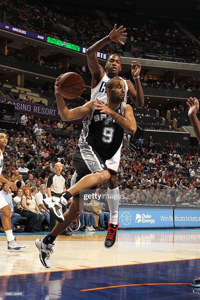 Tony Parker #9 of the San Antonio Spurs passes against the Charlotte Bobcats at the Time Warner Cable Arena on December 8, 2012 in Charlotte, North Carolina.