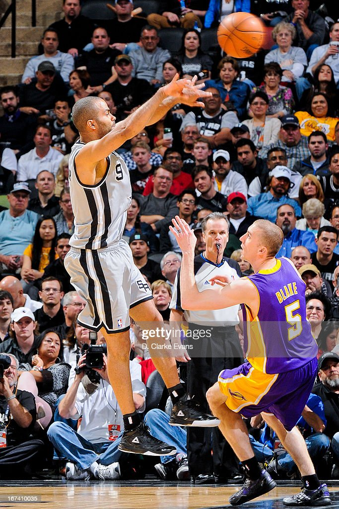 Tony Parker #9 of the San Antonio Spurs passes the ball against Steve Blake #5 of the Los Angeles Lakers in Game Two of the Western Conference Quarterfinals during the 2013 NBA Playoffs on April 24, 2013 at the AT&T Center in San Antonio, Texas.