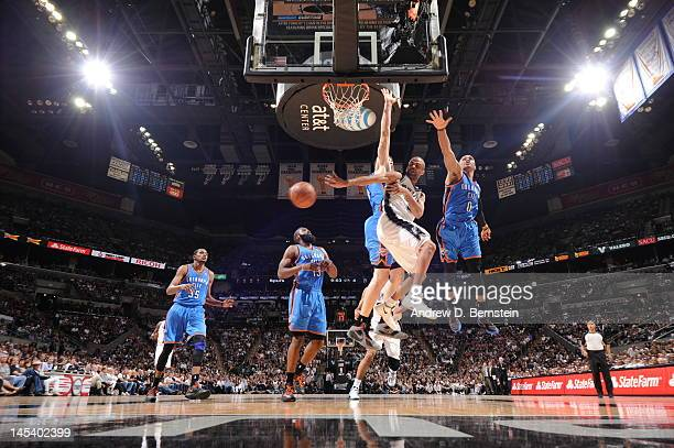 Tony Parker of the San Antonio Spurs passes the ball behind his back during the game against the Oklahoma City Thunder in Game One of the Western...