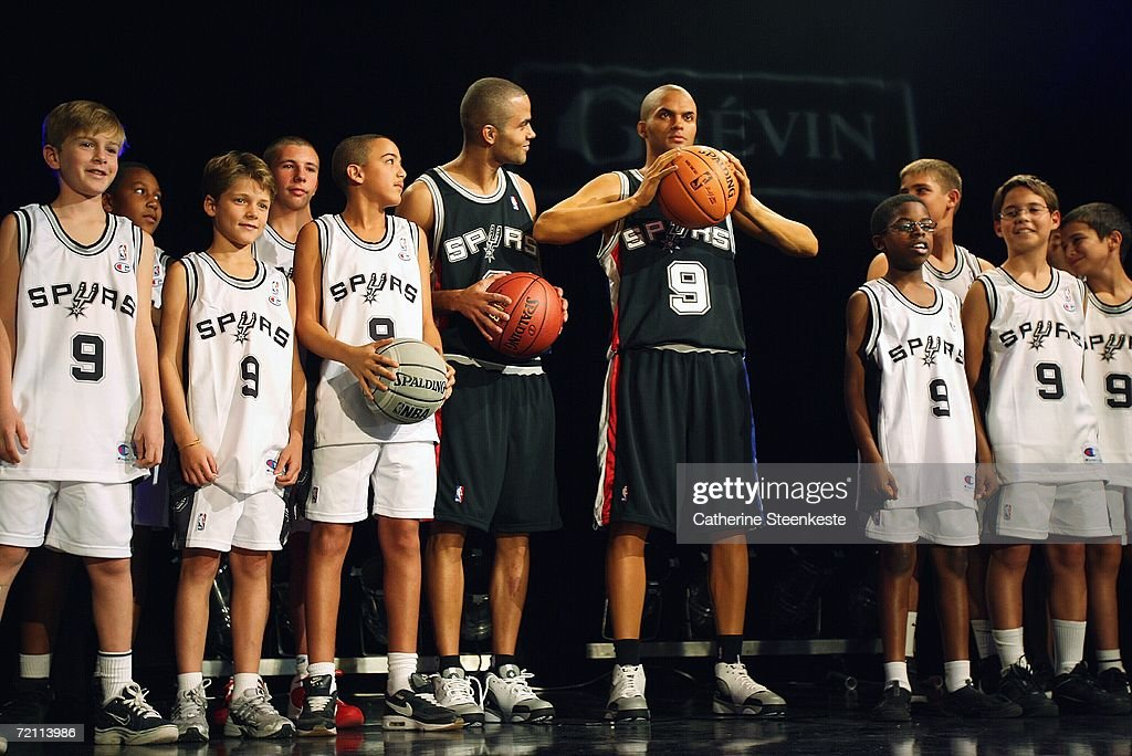 Tony Parker #9 of the San Antonio Spurs poses with a with a wax figure in his likeness and fans at the Grevin Wax Museum during the NBA Europe Live presented by EA Sports on October 7, 2006 in Paris, France.