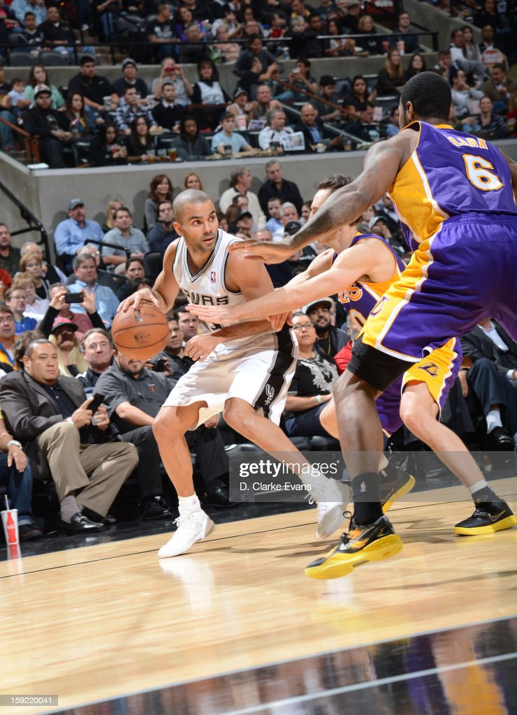 Tony Parker #9 of the San Antonio Spurs protects the ball during the game between the Los Angeles Lakers and the San Antonio Spurs on January 9, 2013 at the AT&T Center in San Antonio, Texas.