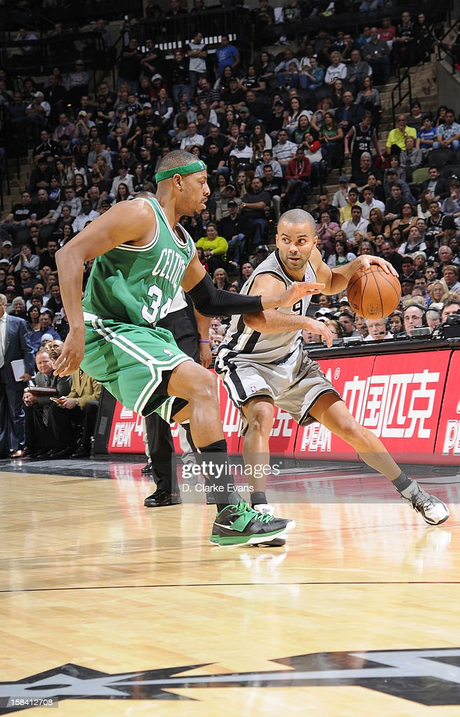 Tony Parker #9 of the San Antonio Spurs protects the ball from <a gi-track='captionPersonalityLinkClicked' href=/galleries/search?phrase=Paul+Pierce&family=editorial&specificpeople=201562 ng-click='$event.stopPropagation()'>Paul Pierce</a> #34 of the Boston Celtics during the game between the Boston Celtics and the San Antonio Spurs on December 15, 2012 at the AT&T Center in San Antonio, Texas.