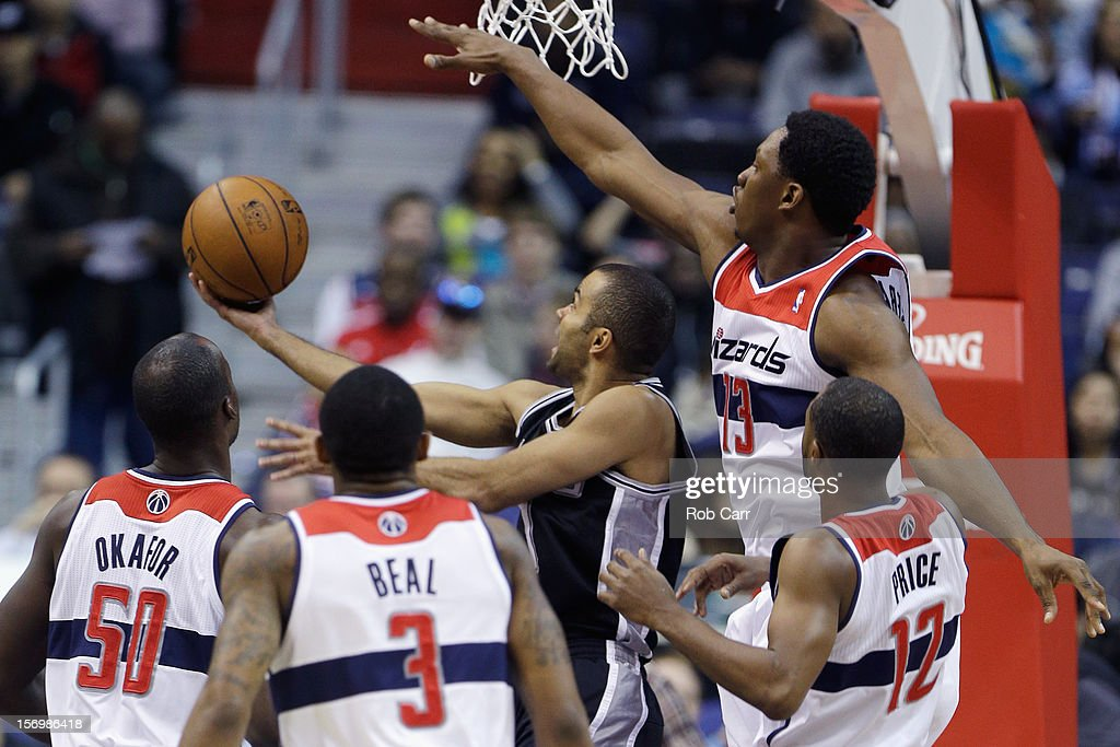 Tony Parker #9 of the San Antonio Spurs puts up a shot in front of <a gi-track='captionPersonalityLinkClicked' href=/galleries/search?phrase=Kevin+Seraphin&family=editorial&specificpeople=6474998 ng-click='$event.stopPropagation()'>Kevin Seraphin</a> #13 of the Washington Wizards during the first half at Verizon Center on November 26, 2012 in Washington, DC.