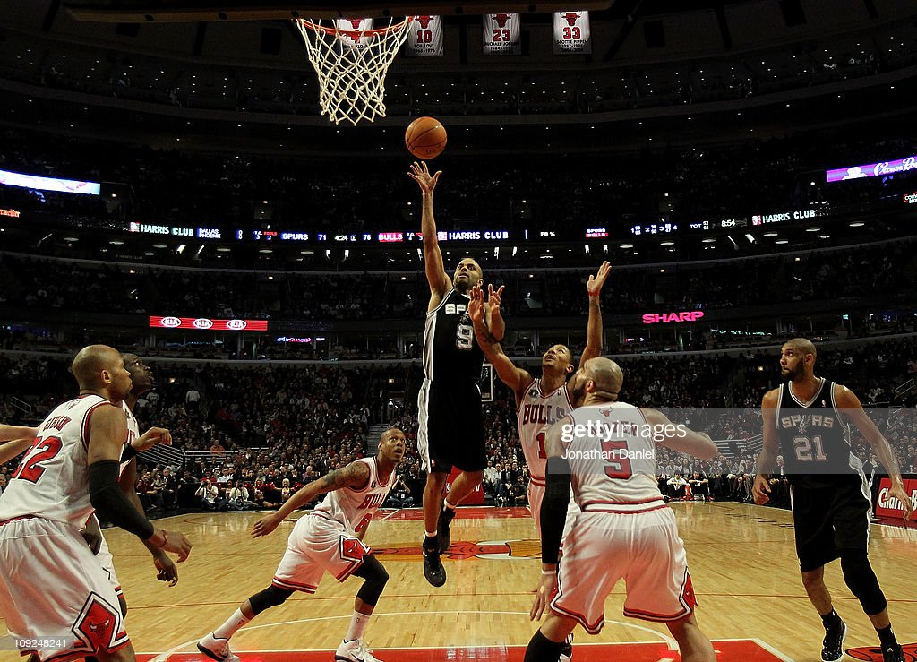 Tony Parker #9 of the San Antonio Spurs puts up a shot over (L-R) Keith Bogans #6, Derrick Rose #1 and Carlos Boozer #5 of the Chicago Bulls at the United Center on February 17, 2011 in Chicago, Illinois. The Bulls defeated the Spurs 109-99.