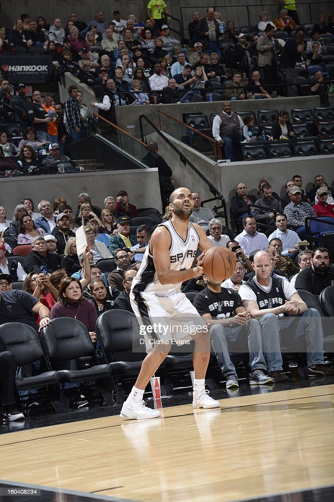 Tony Parker #9 of the San Antonio Spurs sets-up for a wideopen shot against the Charlotte Bobcats on January 30, 2013 at the AT&T Center in San Antonio, Texas.