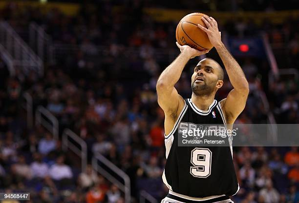 Tony Parker of the San Antonio Spurs shoot a free throw shot during the NBA game against the Phoenix Suns at US Airways Center on December 15 2009 in...