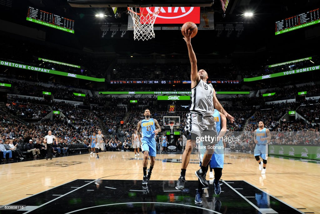 Tony Parker #9 of the San Antonio Spurs shoots a lay up during the game against the Denver Nuggets on February 4, 2017 at the AT&T Center in San Antonio, Texas.